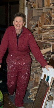 Me in my stylish red overalls in front of my wood store